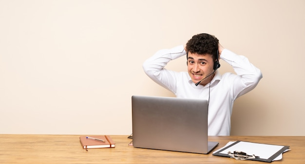 Telemarketer man frustrated and takes hands on head