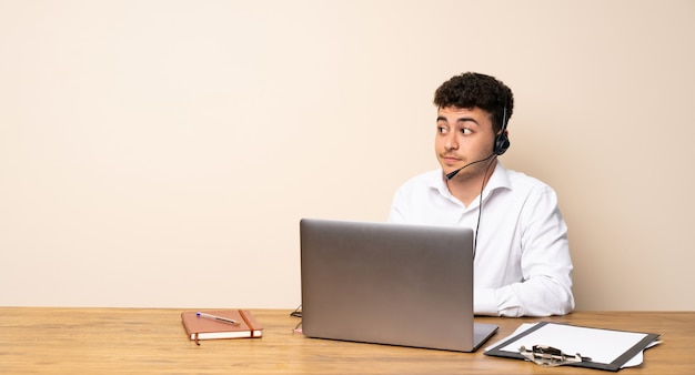 Telemarketer man making doubts gesture looking side
