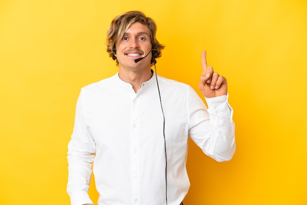 Telemarketer man working with a headset isolated