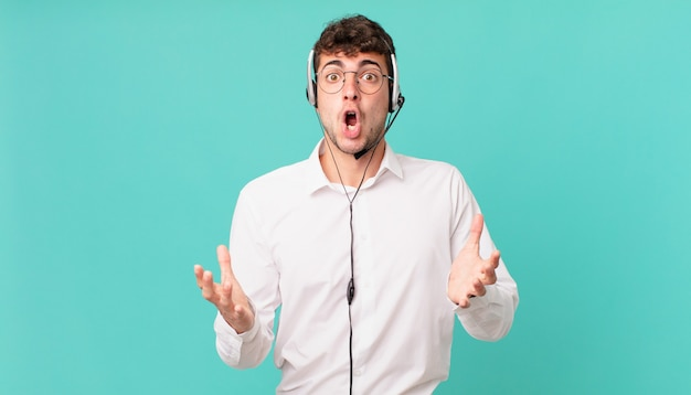 Telemarketer open-mouthed and amazed, shocked and astonished with an unbelievable surprise