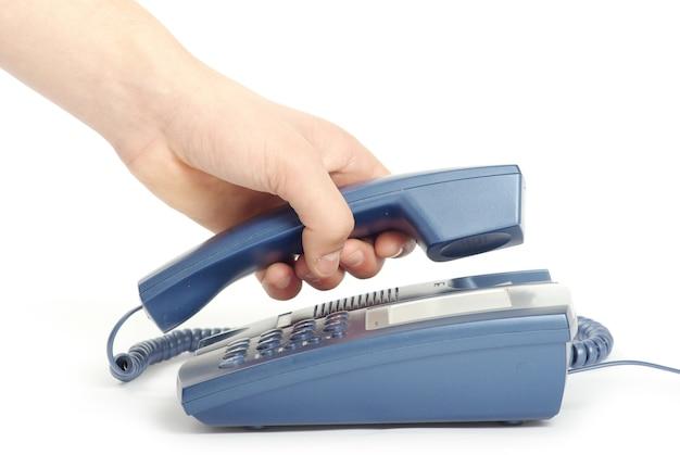 흰색 절연 손에 전화 수신기
