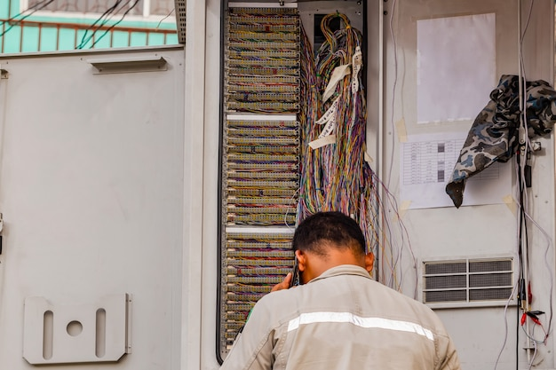 Telephone technician checks the coaxial cable
