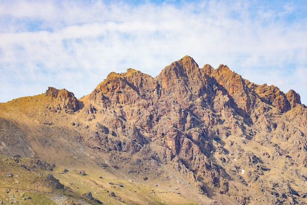 Telephoto detailed view of rocky mountain peak and jagged ridge