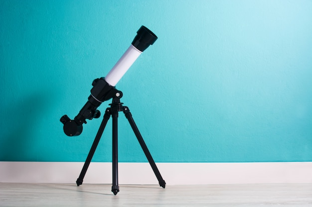 Telescope in a boy's room copyspace