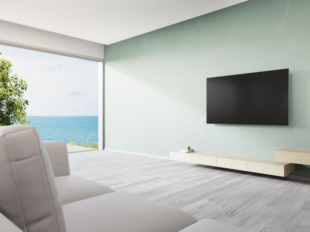 Television shelf on turquoise wall of large living room and sofa near tv in modern beach house