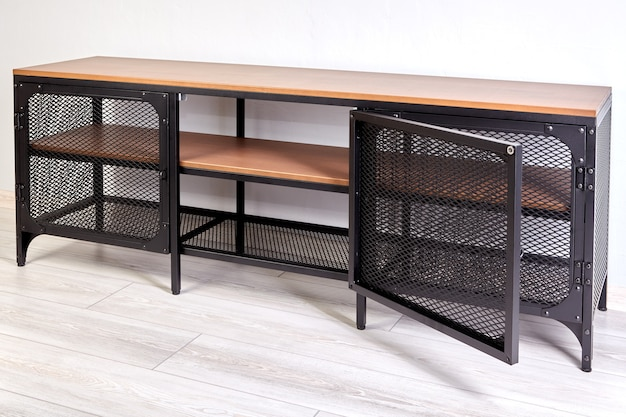 Television stand made of wrought iron with metal black frame and wooden shelves