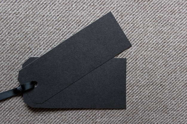 Template mockup with two sale tag labels on textured fabric