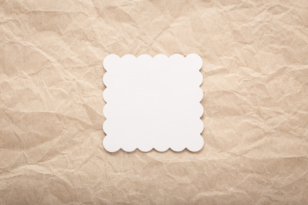 Template of white cardboard card on crumpled paper. paper layout