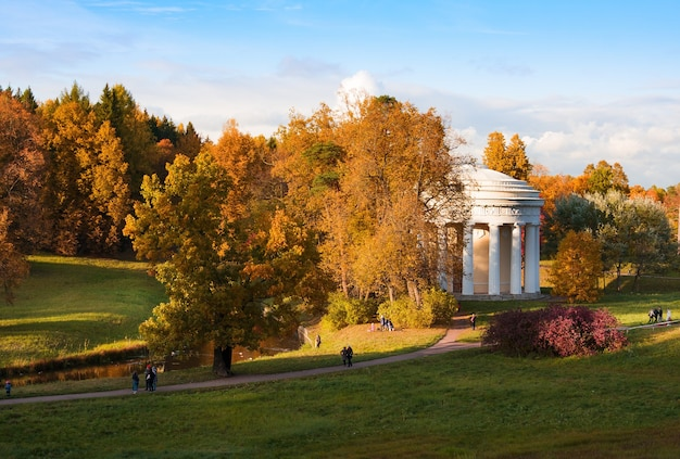 Temple of friendship on bank of slavyanka river in colorful autumn. pavlovsk. russia.