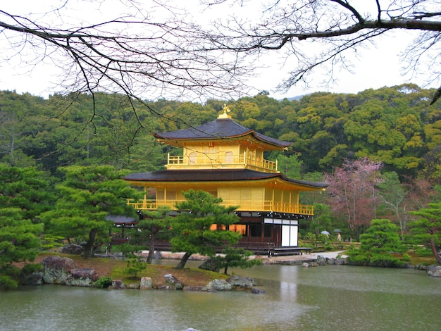 Temple of the golden pavilion with a lake