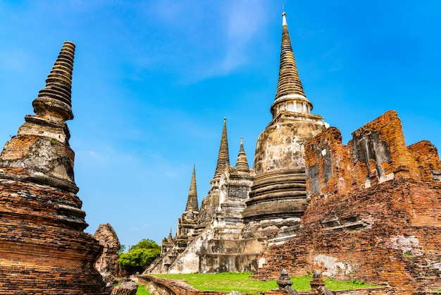 Temple ruins and the pagoda at wat phra si sanphet in ayutthaya historical park in thailand.