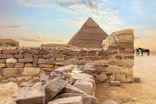 Temple ruins and the pyramid of khafre, giza, egypt.