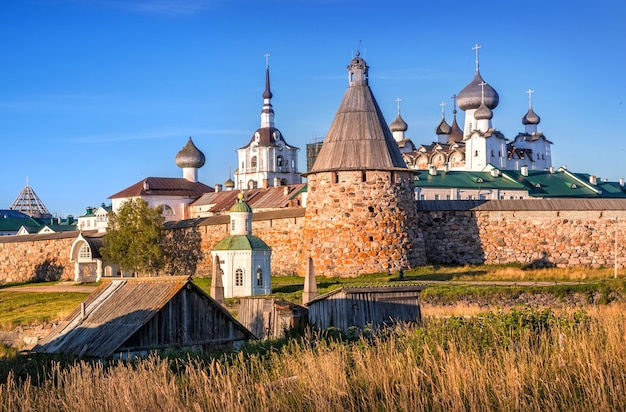Temples and towers of the solovetsky monastery on the solovetsky islands and yellow autumn grass