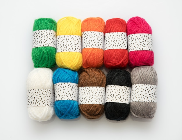 Ten assorted colors of wool yarn in balls