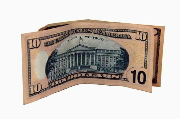 白い背景に10ドル紙幣