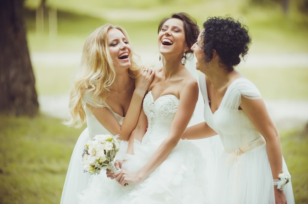 Tender bride with bridesmaids on wedding day