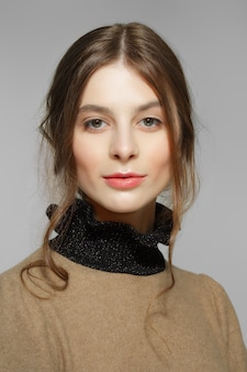 Tender fashion model with light red lips and pink cheeks. clean fresh face of pretty girl with natural makeup.