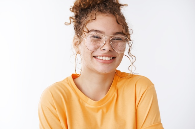 Tender happy smiling redhead cute 20s young girl wearing glasses giggling feeling joyful optimistic have lucky day standing amused full energy white background, having fun chilling party