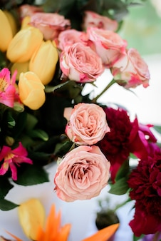 Tender pink roses put in a bouquet