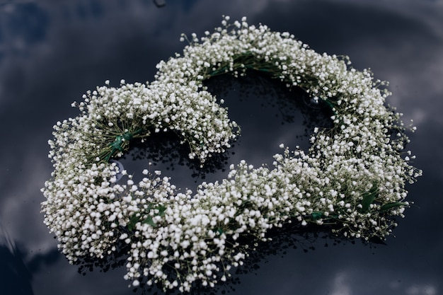 Tender wreath of gypsophila on the car windscreen