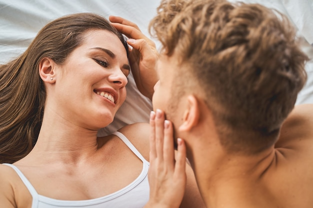 Tenderness in the air. kind brunette woman keeping smile on her face while listening to her partner