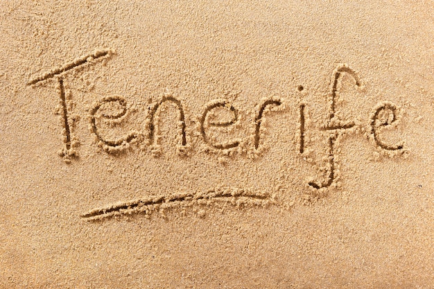 Tenerife summer beach writing message