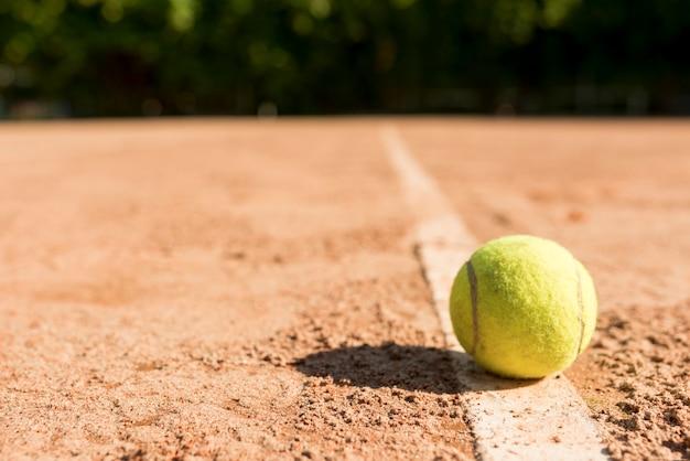 Tennis ball on the ground