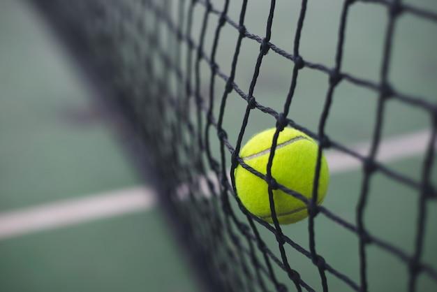 Tennis ball hitting to the net