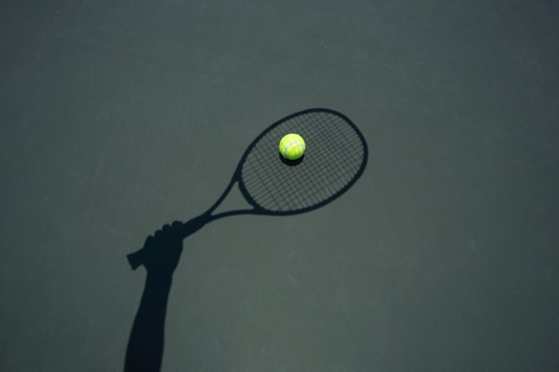 Tennis ball with racket on the tennis court.