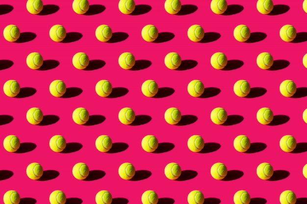 Tennis ball with strong shadow on pink