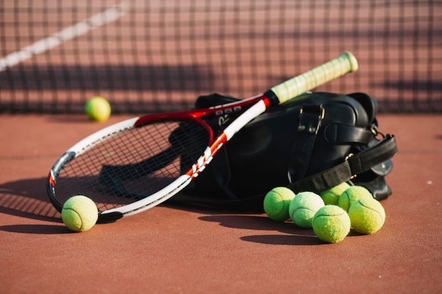 Tennis balls and racket on the tennis field