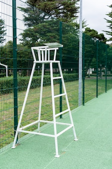 Tennis chair on outdoor court