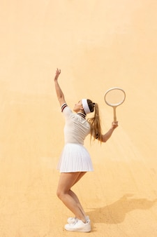 Tennis match with young woman