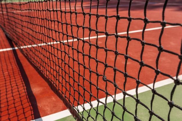 Tennis net on a tennis court