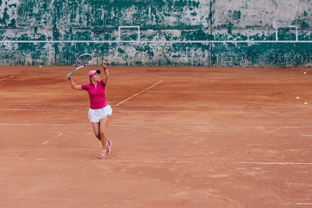 Tennis player. active sportive woman playing tennis, ready for receive a ball