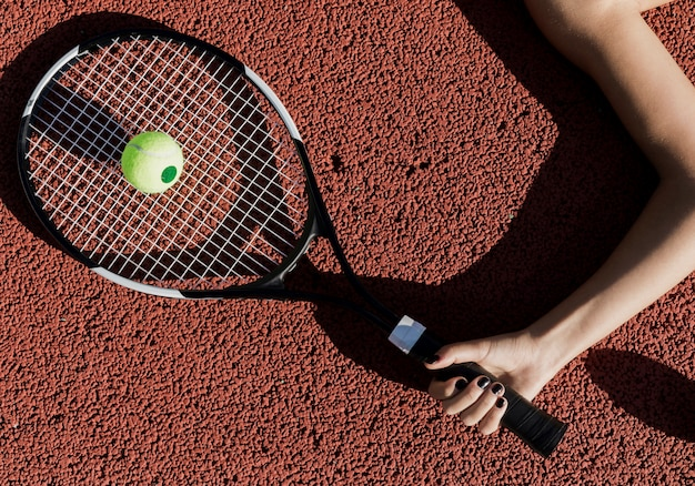 Tennis player holding racket top view