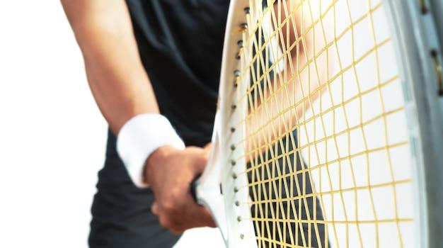 Tennis player holding tennis racket on white background, closeup