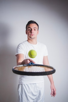 Tennis player juggling ball
