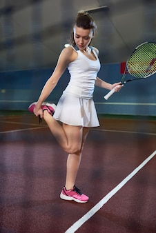 Tennis player warming up for practice