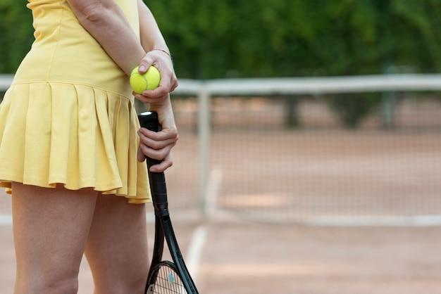 Tennis player with her racket