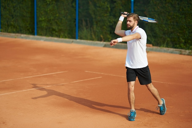 Tennis player with racket on the court