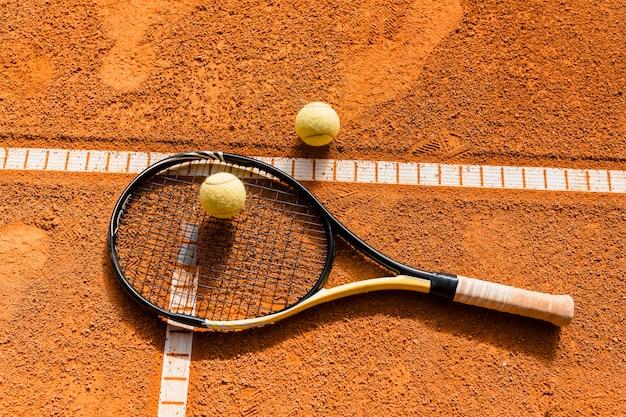 Tennis racket on ball Premium Photo