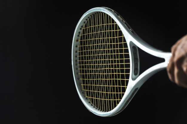 Tennis racket on black background