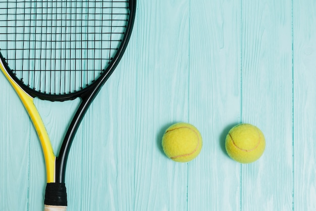 Tennis racket with two yellow balls