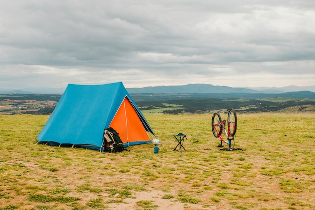 Tent and bike in countryside
