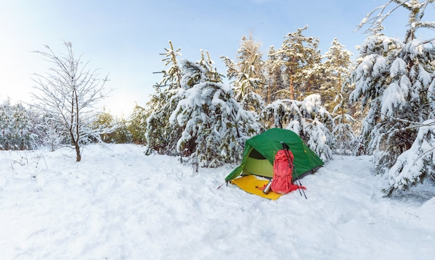 Tent camping snow shoes backpack all the necessary equipment for a winter hike.