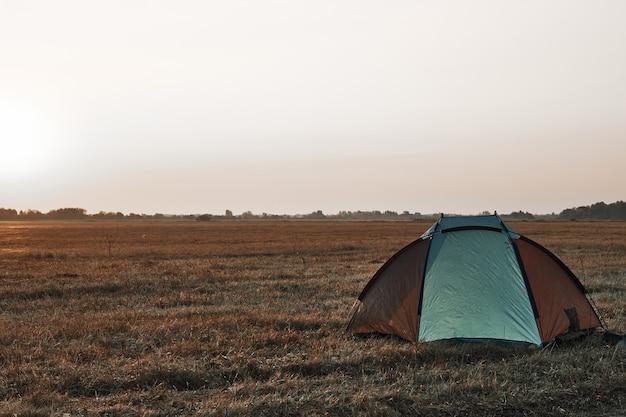 Tent in the field, sunrise, autumn.