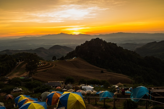 Tent in the sunset overlooking mountains