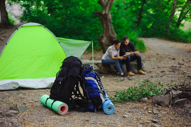 The tent, two backpacks near a tourist track in mountains