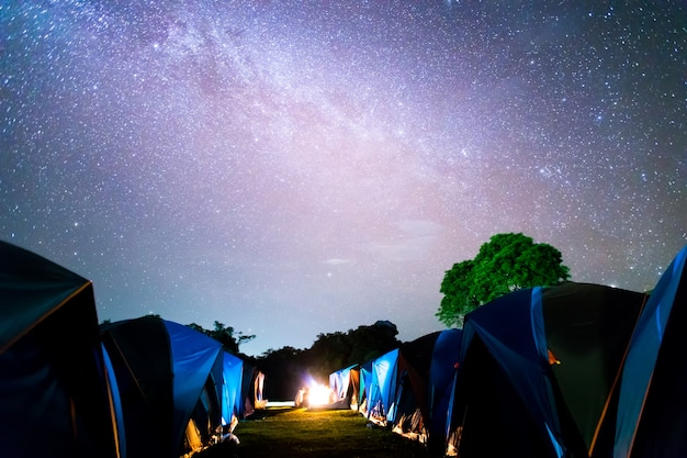 Tents at doi samer daw, night photography of milky way  above tents at sri nan national park, thailand